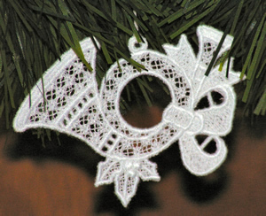 Free standing lace horn ornament