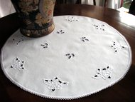 Table topper with cutwork lace embroidery